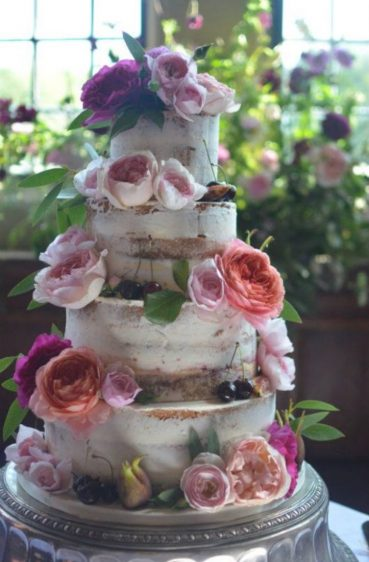 Close up of semi-naked wedding cake at Rhinefield House