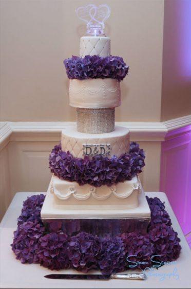 White wedding cake with fresh hydrangeas.