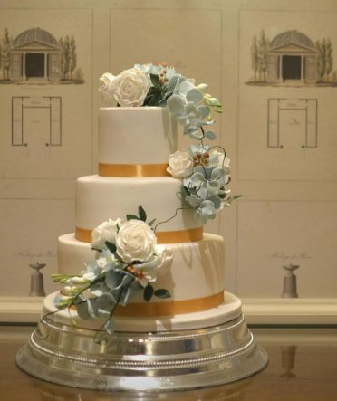 Teal & Bronze wedding cake at Chewton Glen Hotel