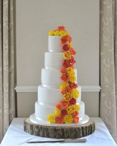 5 Tier wedding cake with sugar marigolds New Forest