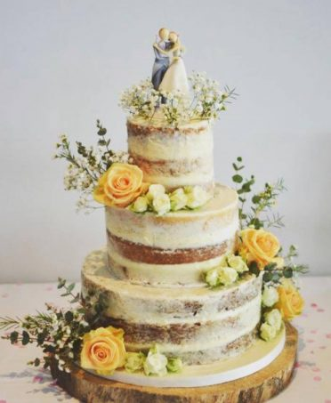 Semi-naked wedding cake at Poole Yacht Club