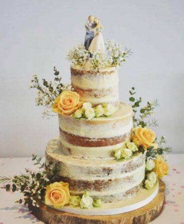 Semi-naked wedding cake at Poole Yacht Club