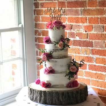 Semi-naked wedding cake at Sopley Mill