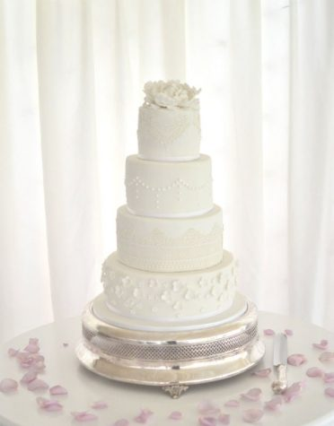 White lace & petals wedding cake at Parley Manor