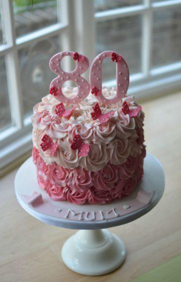 Pink ombre butterflies cake