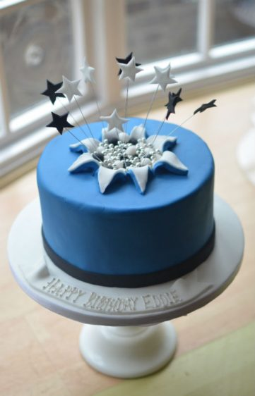 Mans bursting stars cake