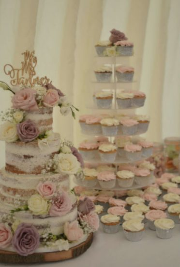 Semi-naked wedding cake with matching cupcakes