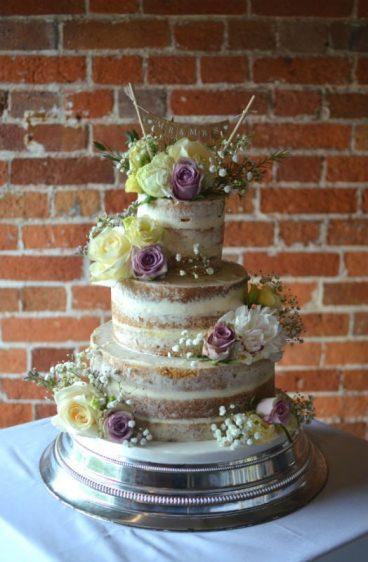 Semi-naked wedding cake at Sopley Mill