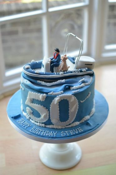 Personalised rib boat birthday cake
