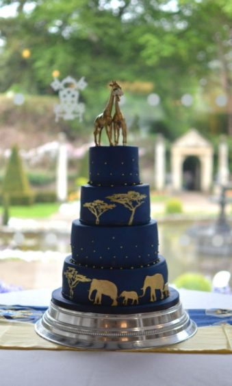 African themed wedding cake midnight blue & gold at Italian Villa