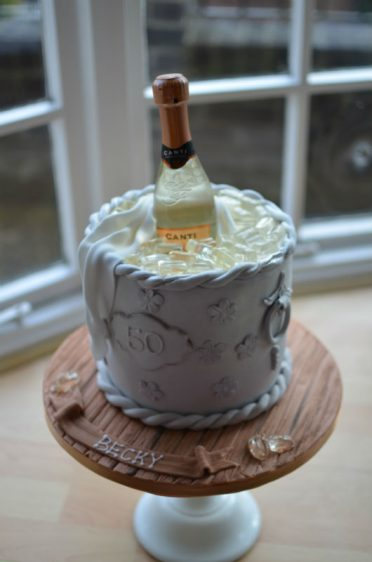 Ice-bucket cake on wood effect base.