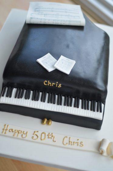 Black grand piano birthday cake