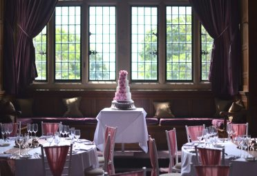 Centrepiece wedding cake in the Great Hall at Rhinefield House