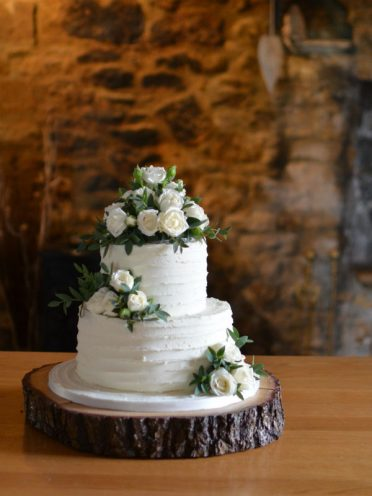 Rustic two tier buttercream frosted wedding cake in Dorset