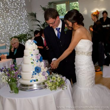 Bride & groom cutting their cake