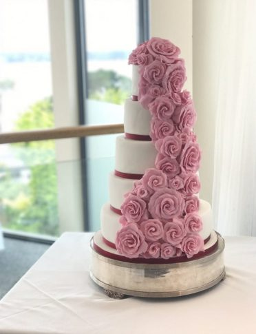 Cascading sugar roses wedding cake at FJB Harbour Heights Hotel