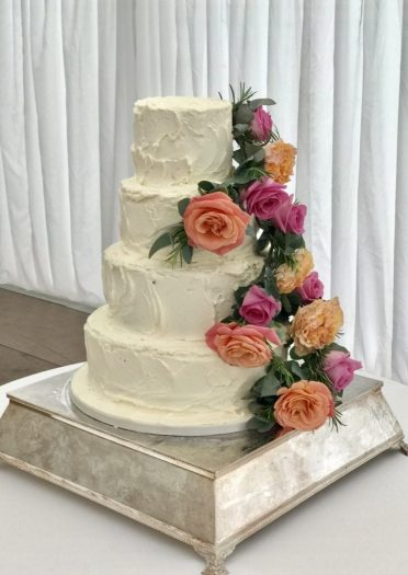 Buttercream coated with fresh flowers at Merley House