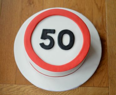 50 road sign cake