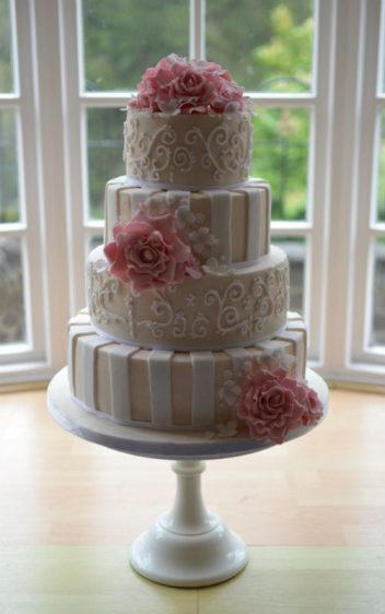 Ivory and white stripes with pink sugar roses.