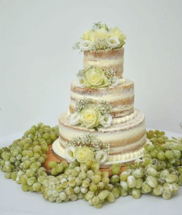 Semi naked wedding cake with frosted grapes at Pennsylvanian Castle