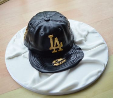 Baseball cap cake with edible gold leaf