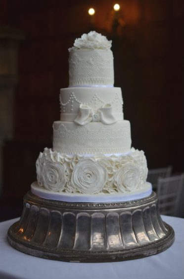 White ruffles wedding cake at Rhinefield House.