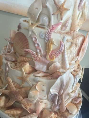 Close up of seahorses wedding cake.