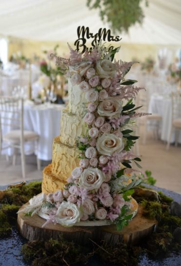 Gold ombre buttercream wedding cake with fresh flowers. At Porchester Villiage.