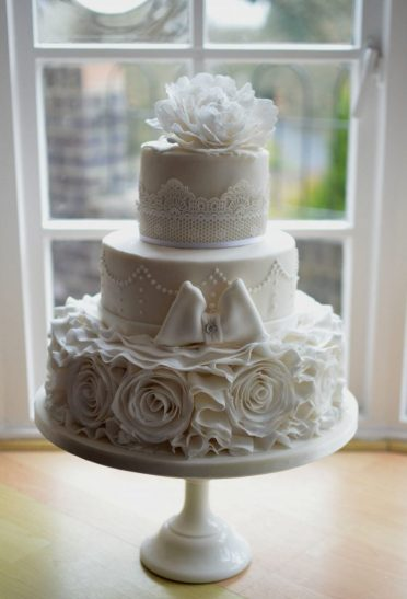 Three tier with rose ruffles delivered to The Kings Hotel Christchurch.