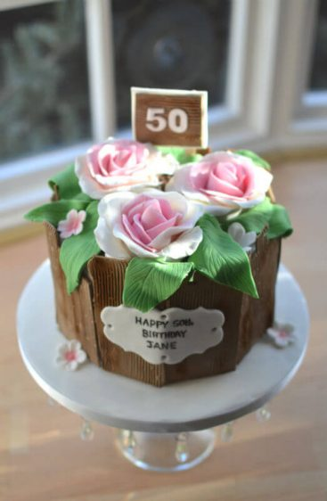 Flower pot cake with sign.