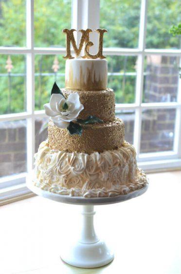 Gold & sugar magnolia wedding cake.