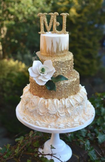 Gold & sugar Magnolia wedding cake.