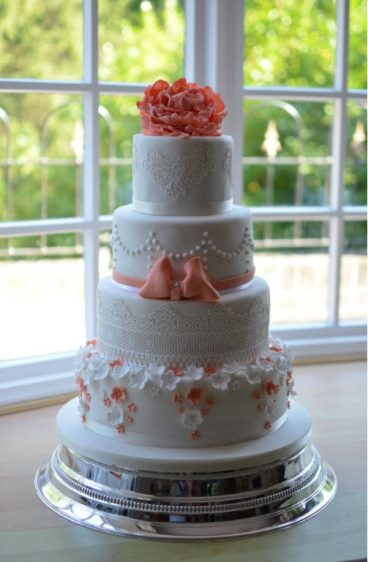 Coral & lace wedding cake delivered to The Harbour Heights Hotel.