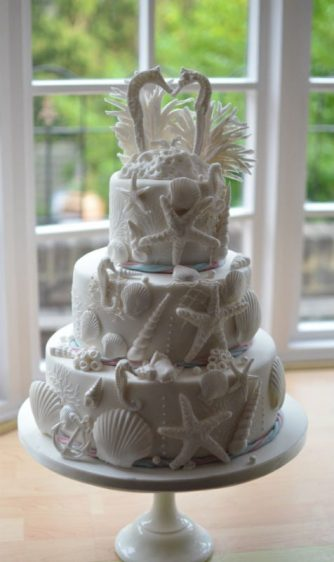 White seahorses shell cake delivered to The Harbour Heights Hotel