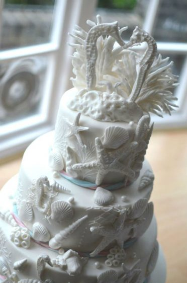 Close up of seahorses white wedding cake