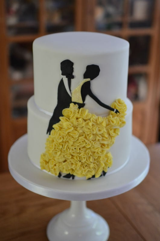 Silhouette dancing ruffle wedding cake at The Captains Club. -