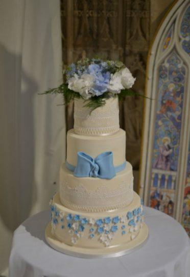 Ivory & lace wedding cake at Highcliffe Castle.