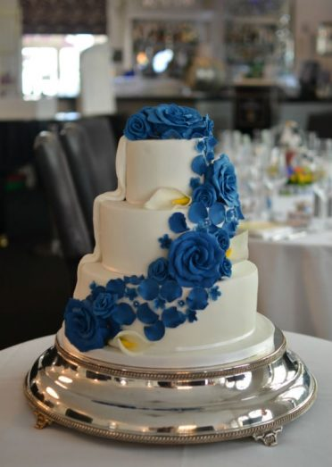 Royal blue roses wedding cake.