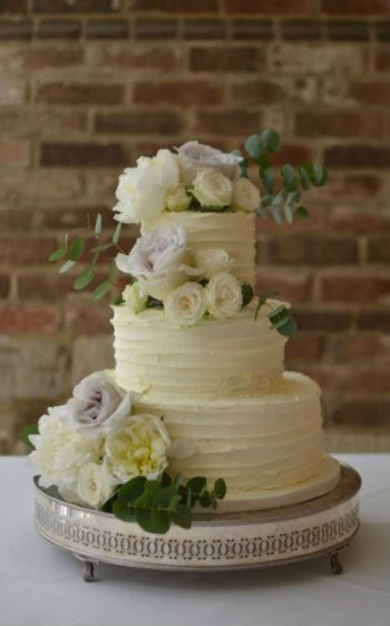 Buttercream coated wedding cake at Athelhampton House.