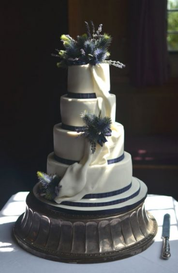 Tartan,Thistle and Drapes wedding cake at Rhinefield House