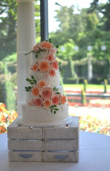 Peach & coral roses wedding cake at The Italian Villa
