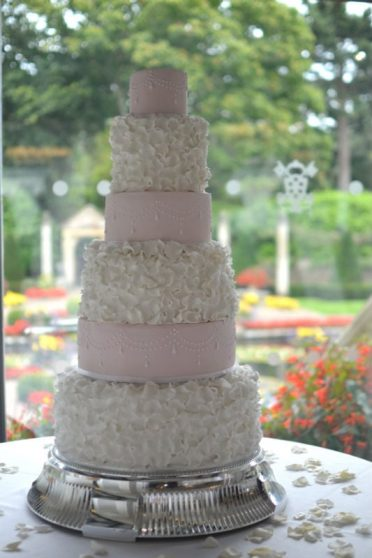 Ruffles & Pearls large six tier wedding cake at Italian Villa