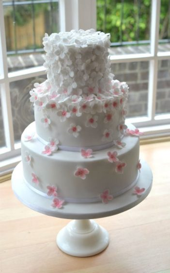 Pretty blossom wedding cake  at The Marriott