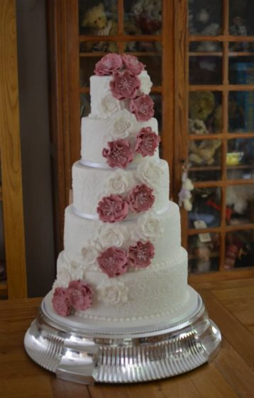 Five tier cascading flowers with frosted coating at Careys Manor Hotel