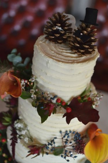 Close up of buttercream frosted wedding cake.