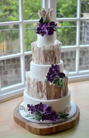 Woodland wedding cake with sugar orchids.