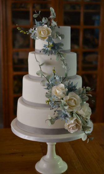 Wired sugar flowers wedding cake NZ colours.