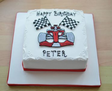Red racing car with flags cake