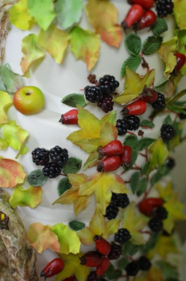 Close up of handmade blackberries and sugar work. Brambly Hedge wedding cake.