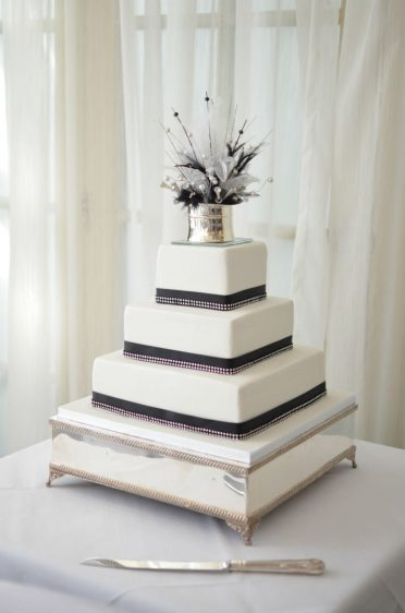Black & white wedding cake with crystals. At the Christchurch Harbour Hotel.